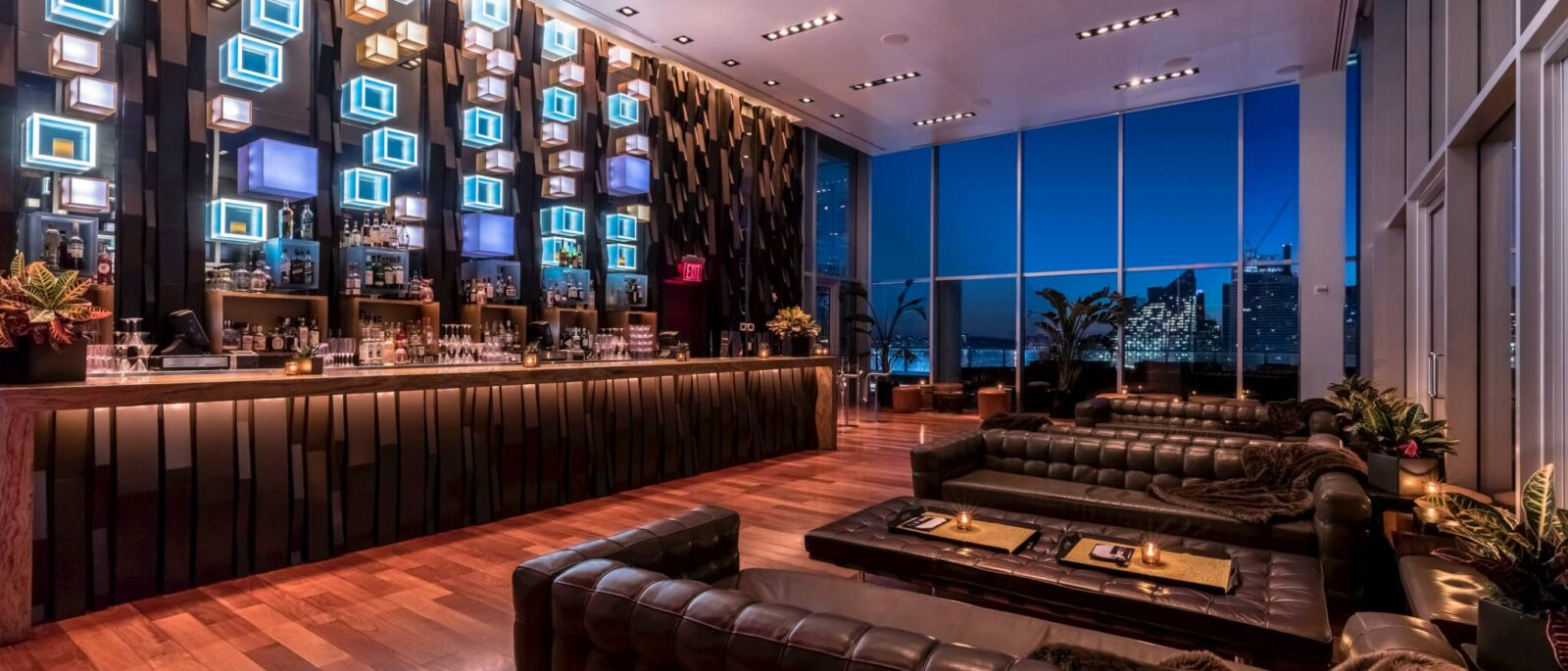 Press Lounge interior at night, showing bar and couches.
